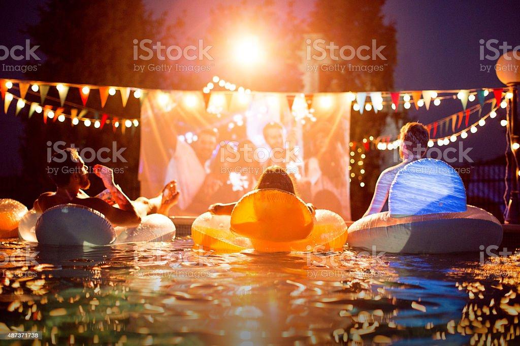 Pool movie night party. stock photo