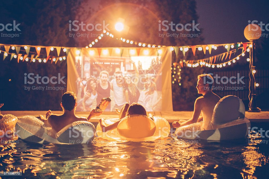 Pool movie night party stock photo