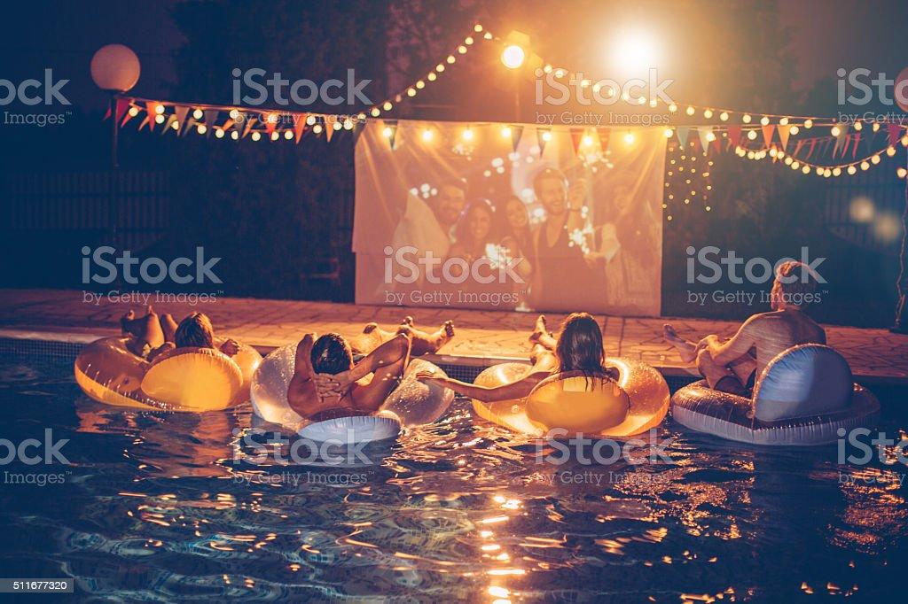 Pool movie night party stock photo