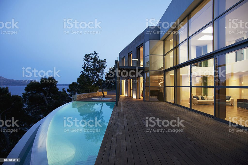Pool outside modern house at twilight royalty-free stock photo
