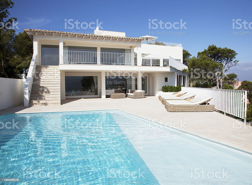 Pool outside modern house royalty-free stock photo