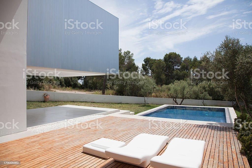 Pool outside modern house stock photo