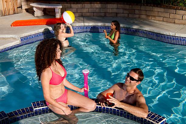 lesbian having sex in a pool
