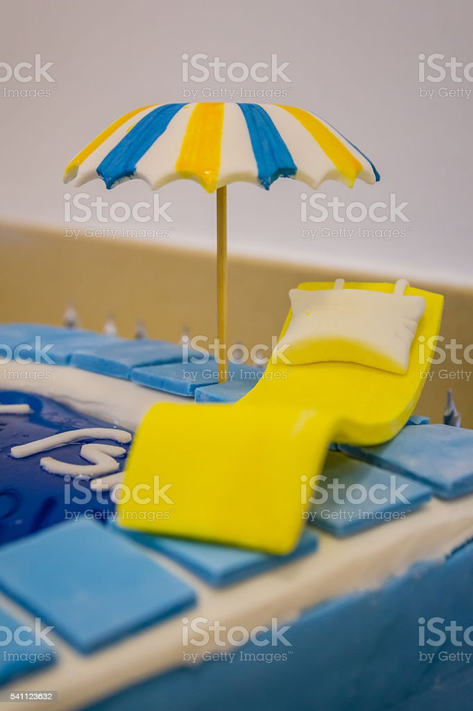 Pool party themed cake with fondant cake decoration stock photo