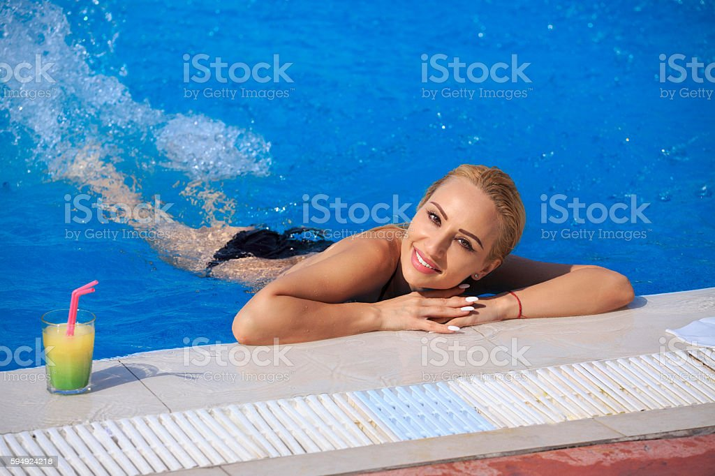 Pool party  Woman  relaxing at swimming pool Summer fun stock photo