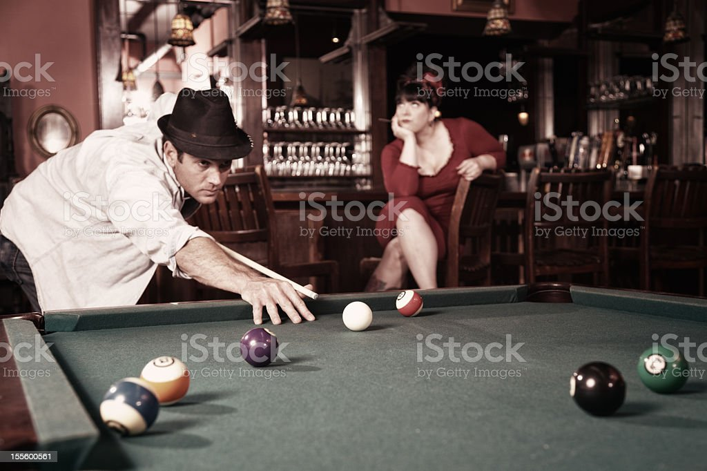 Pool Player and Bored Girlfriend stock photo