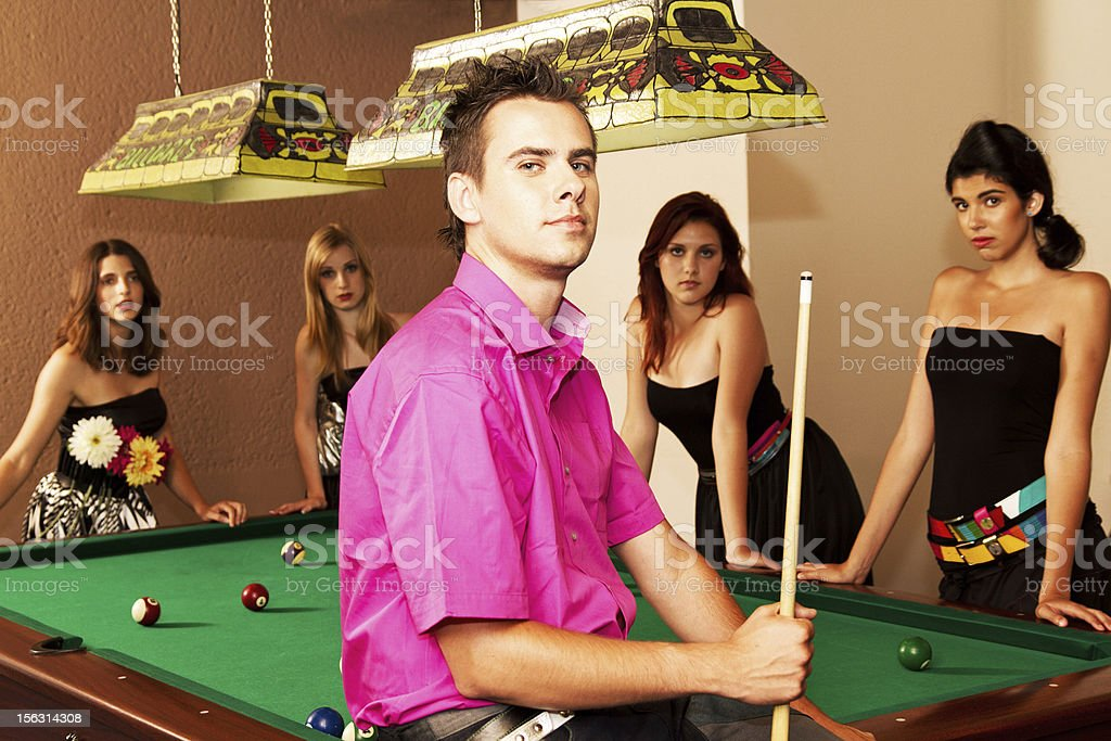 Pool room...four girls and one boy around the table royalty-free stock photo