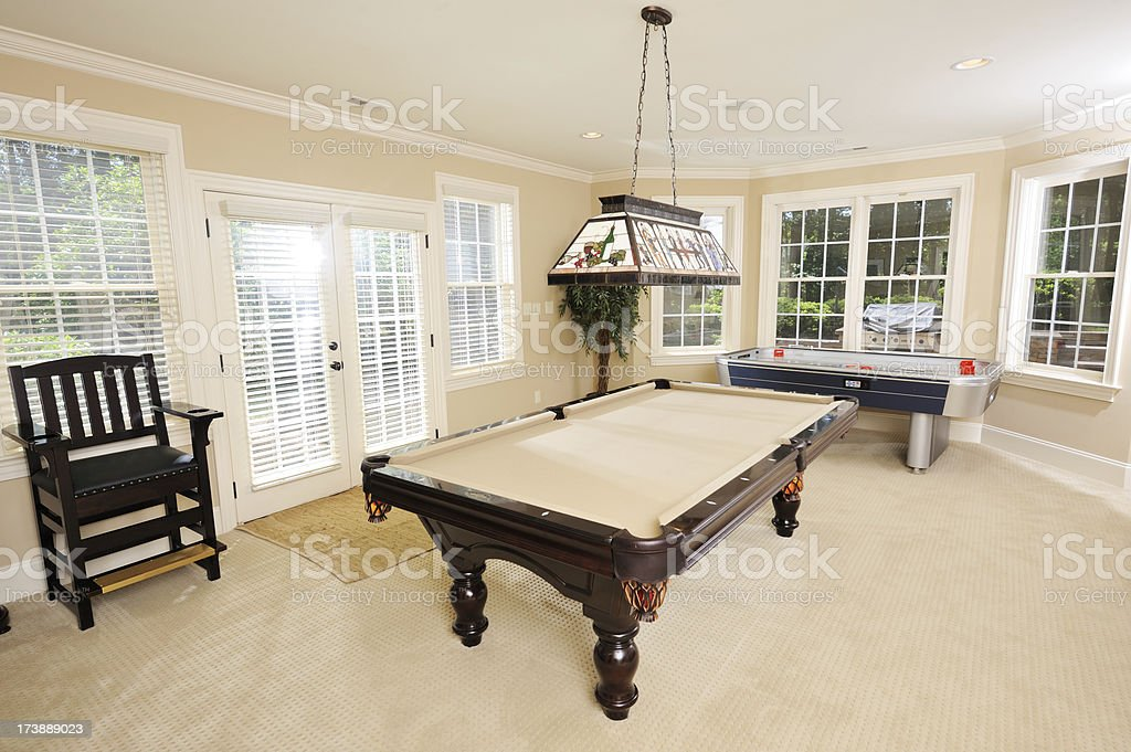 Pool Table in Game Room of Luxury Home stock photo