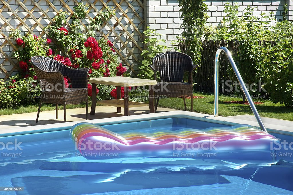 pool with inflatable mattress royalty-free stock photo