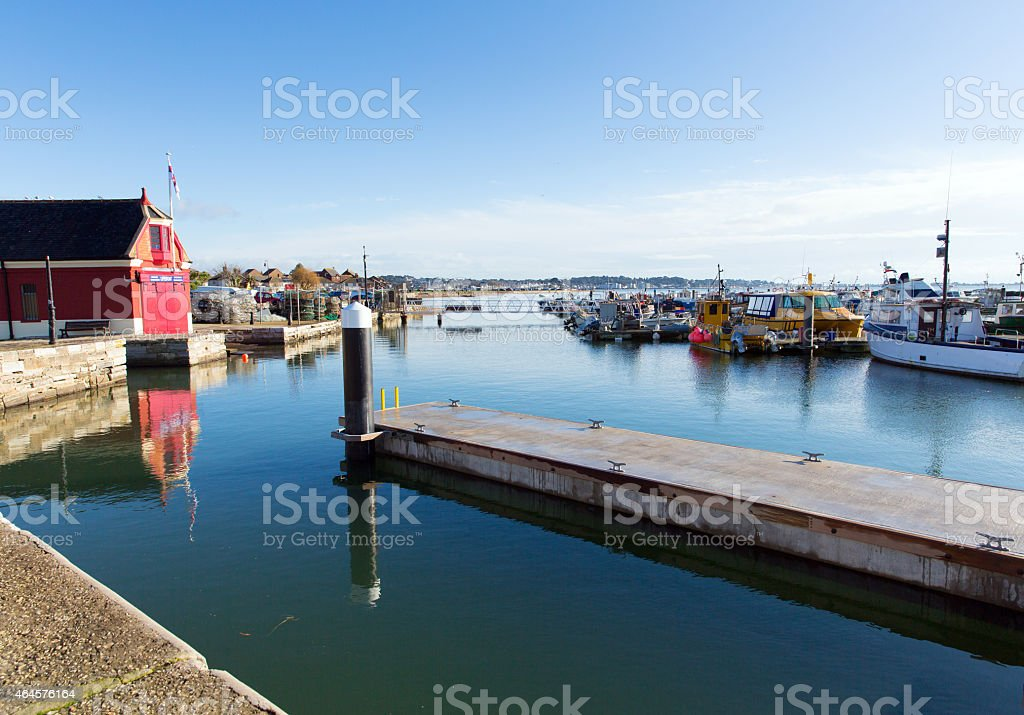 Poole harbour and quay Dorset England UK with boats stock photo