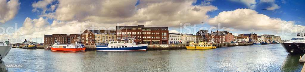 Poole Quay panoramic with harbour boats stock photo