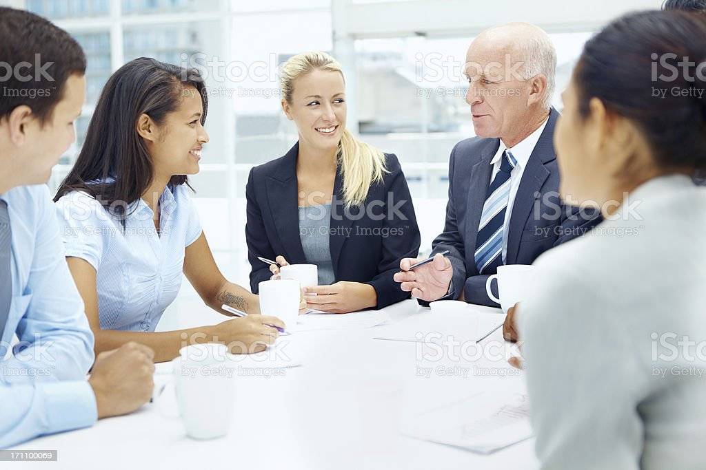 Pooling their ideas to create something amazing royalty-free stock photo