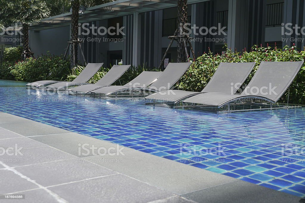 Poolside Bed beach house with pool in modern design pictures, images and stock