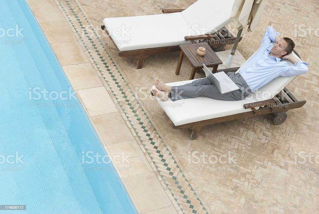 Poolside Daydreaming with Laptop royalty-free stock photo