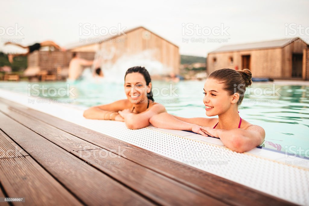 poolside friends relaxing stock photo