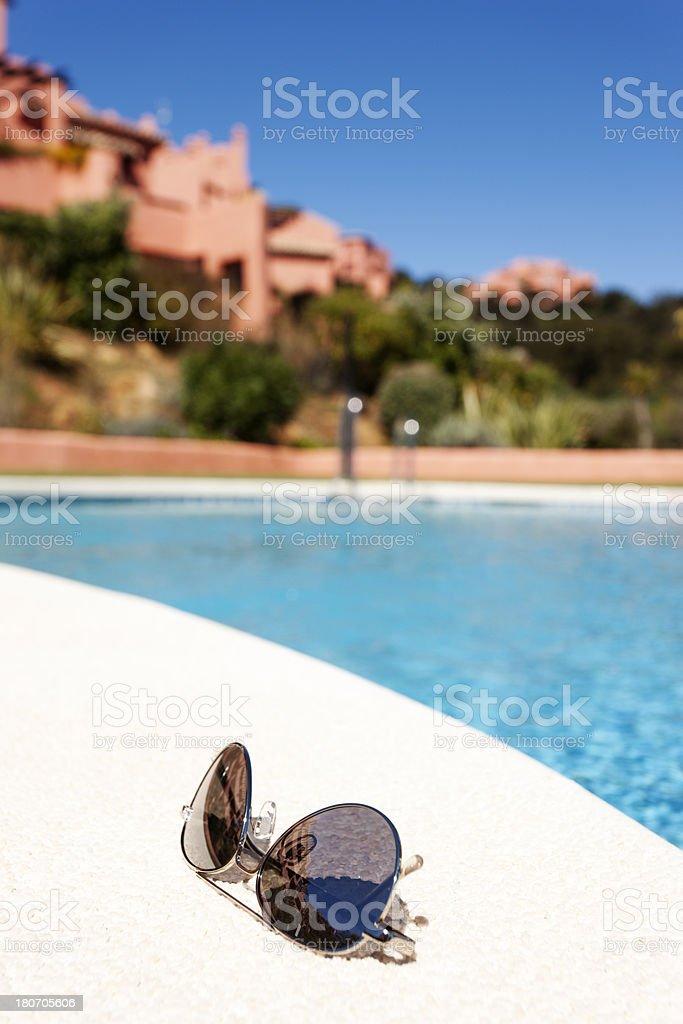 Poolside glasses stock photo