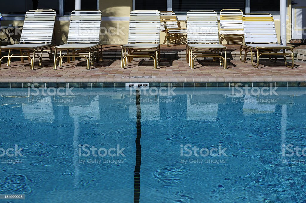 Poolside Lounge Chairs royalty-free stock photo