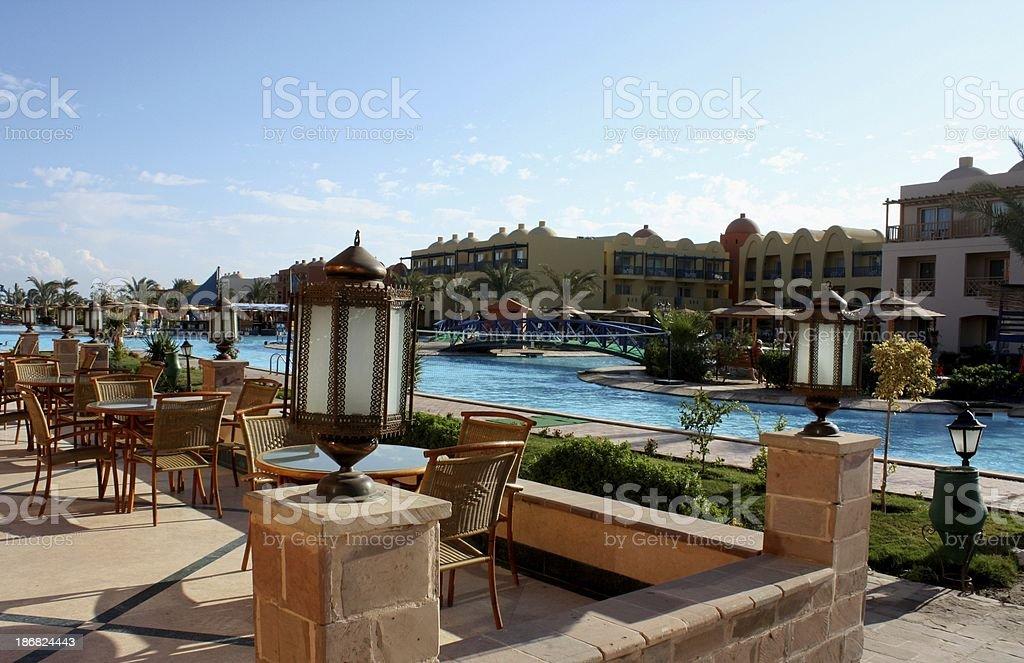 Poolside restaurant in arabian lifestyle royalty-free stock photo