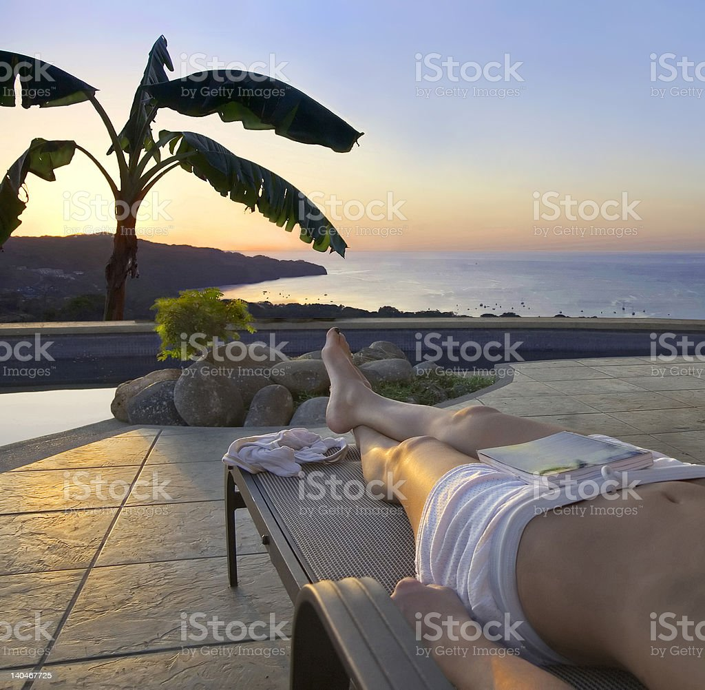 Poolside sunset in the tropics royalty-free stock photo