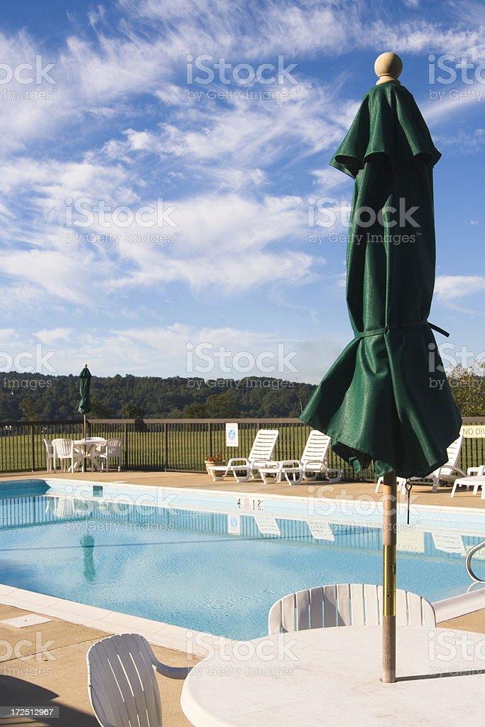 Poolside umbrella stock photo