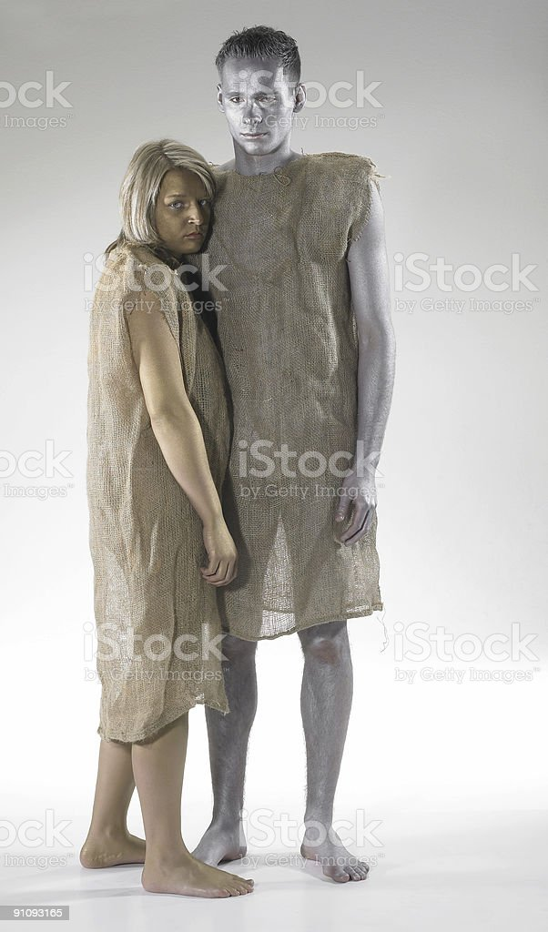 poor couple lean against each other stock photo
