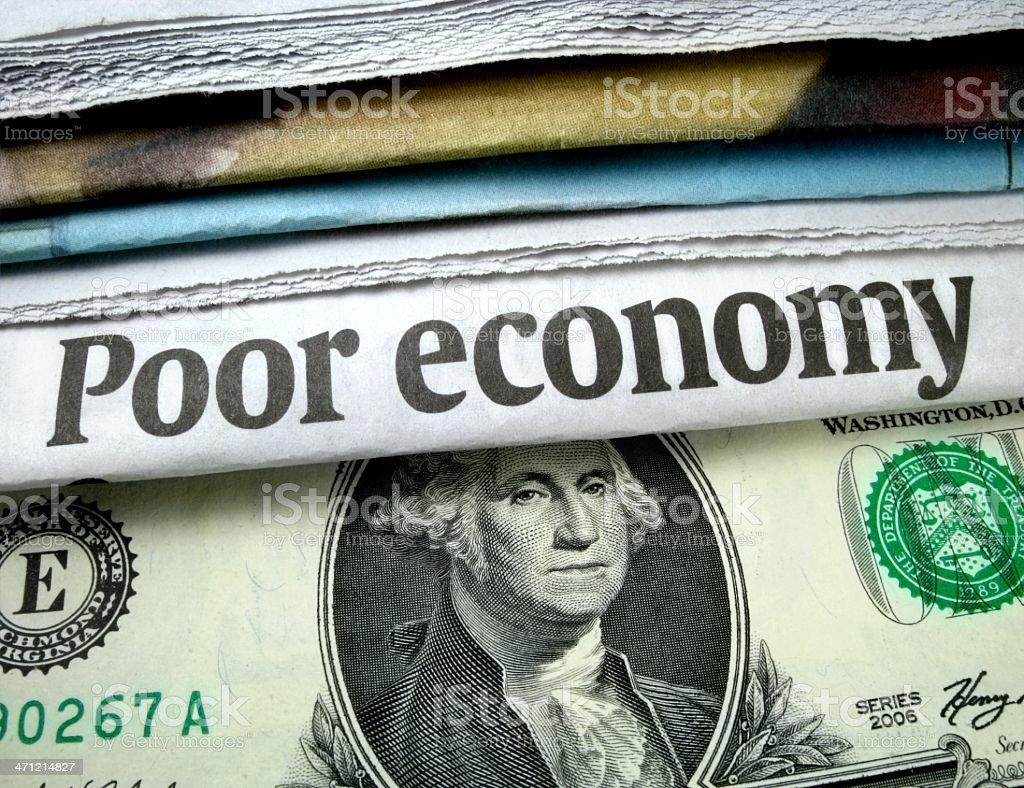 Poor Economy Headline and Currency stock photo