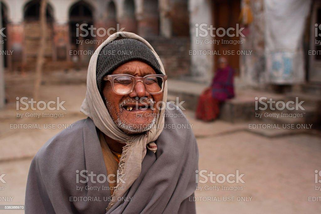 Poor elderly man in vintage glasses walk street stock photo