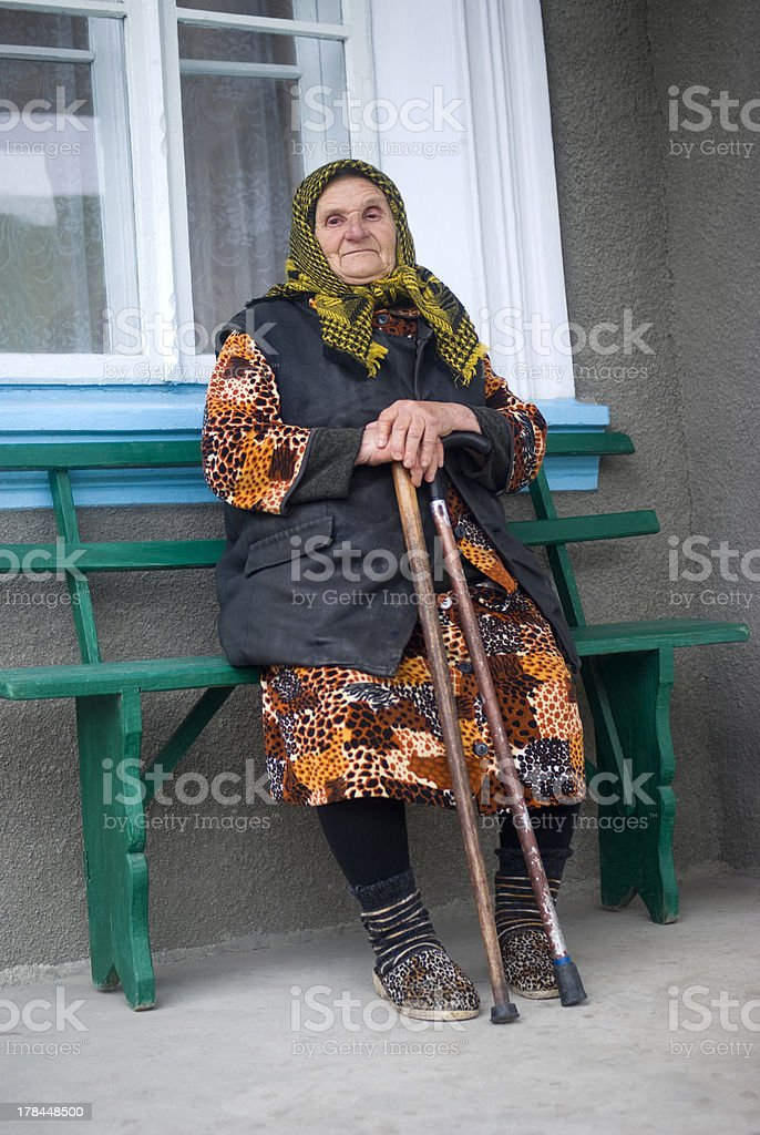 Poor elderly woman of Eastern Europe stock photo