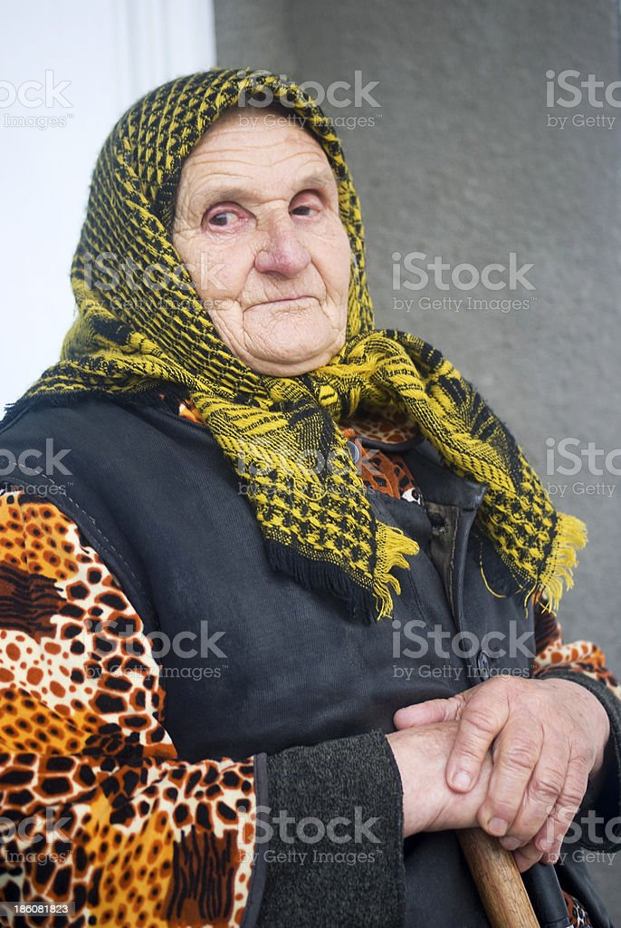 Poor elderly woman stock photo