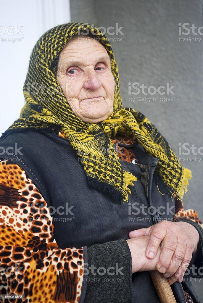 Poor elderly woman stock photo