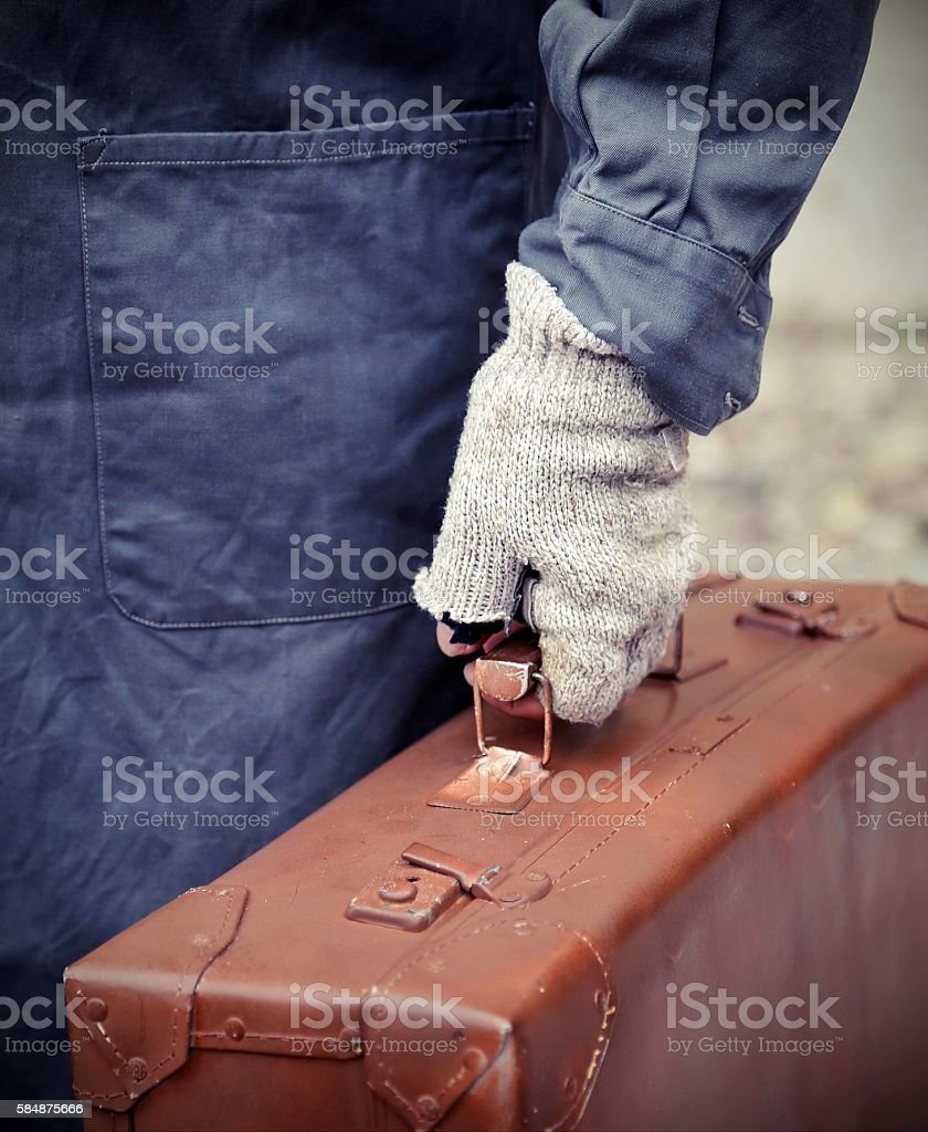 poor emigrated with old leather suitcase stock photo