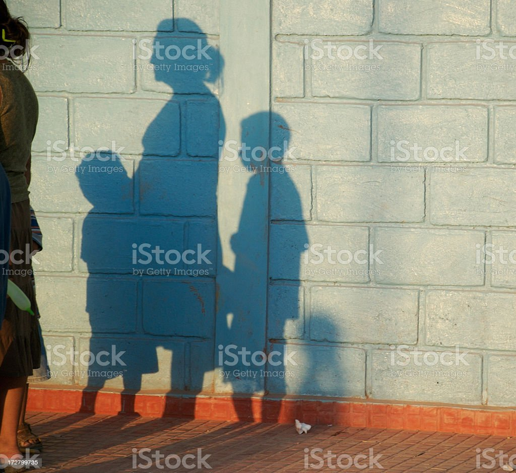 Poor Family in the Shadows stock photo