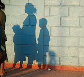 Poor Family in the Shadows