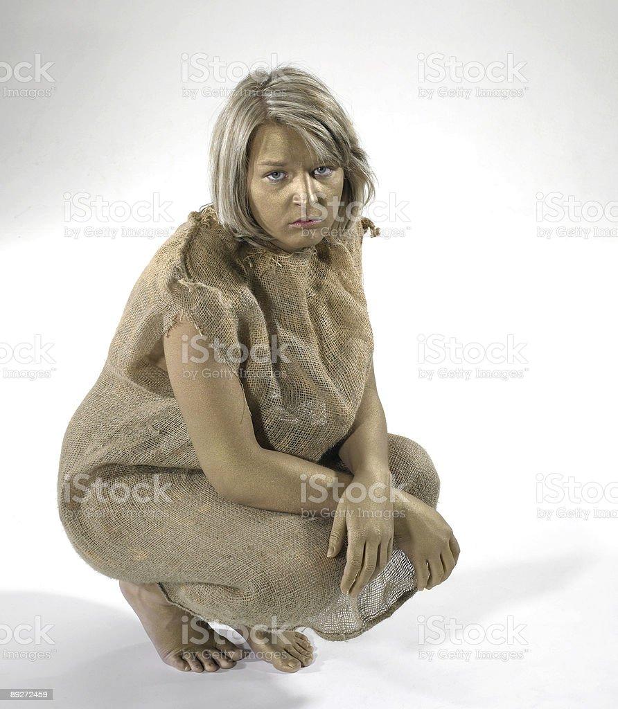 poor girl cowering stock photo