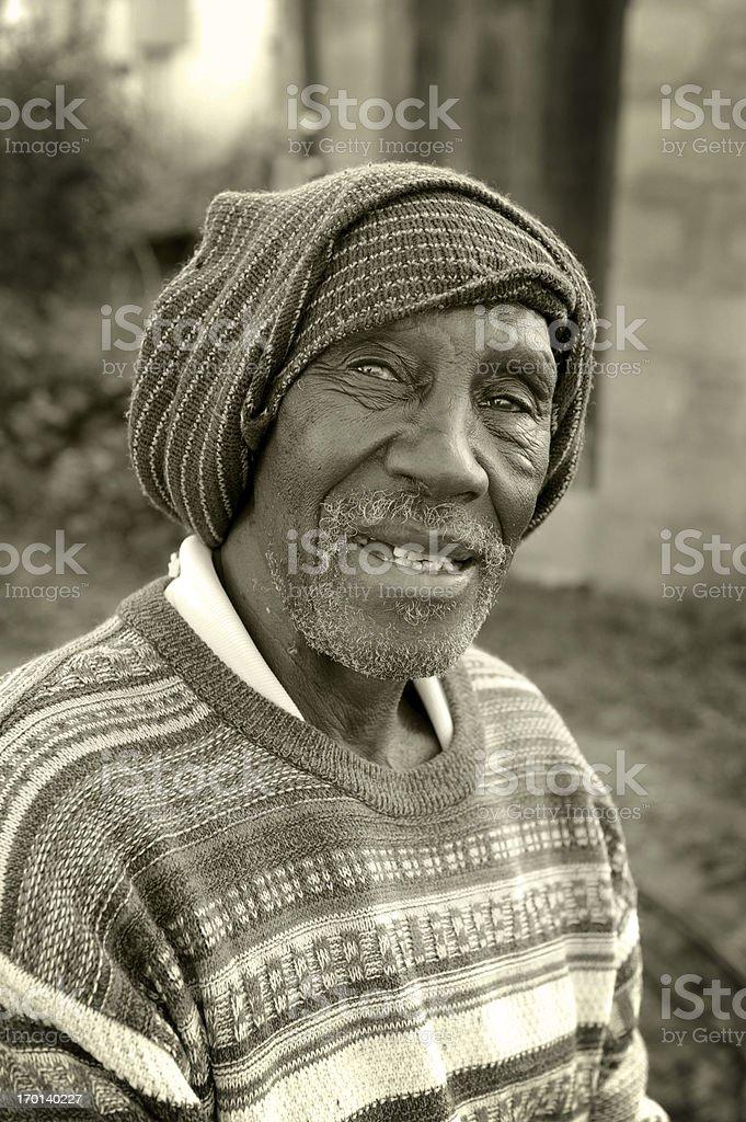 Poor, half blind, old farmworker man. royalty-free stock photo