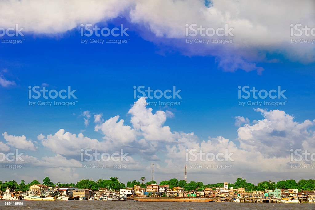 Poor houses built along the river in the Amazon stock photo