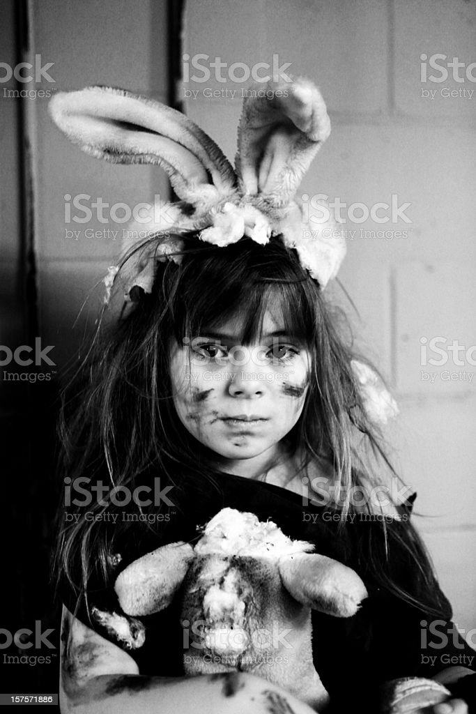 poor little girl playing dress up with homemade costume stock photo