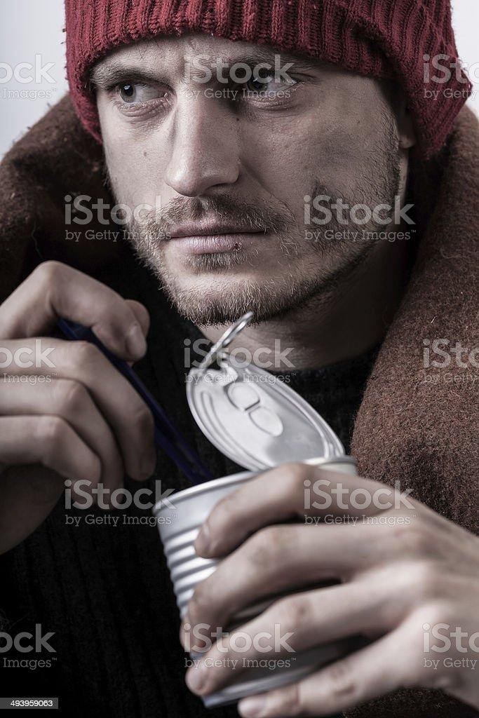 Poor man eating preserve royalty-free stock photo