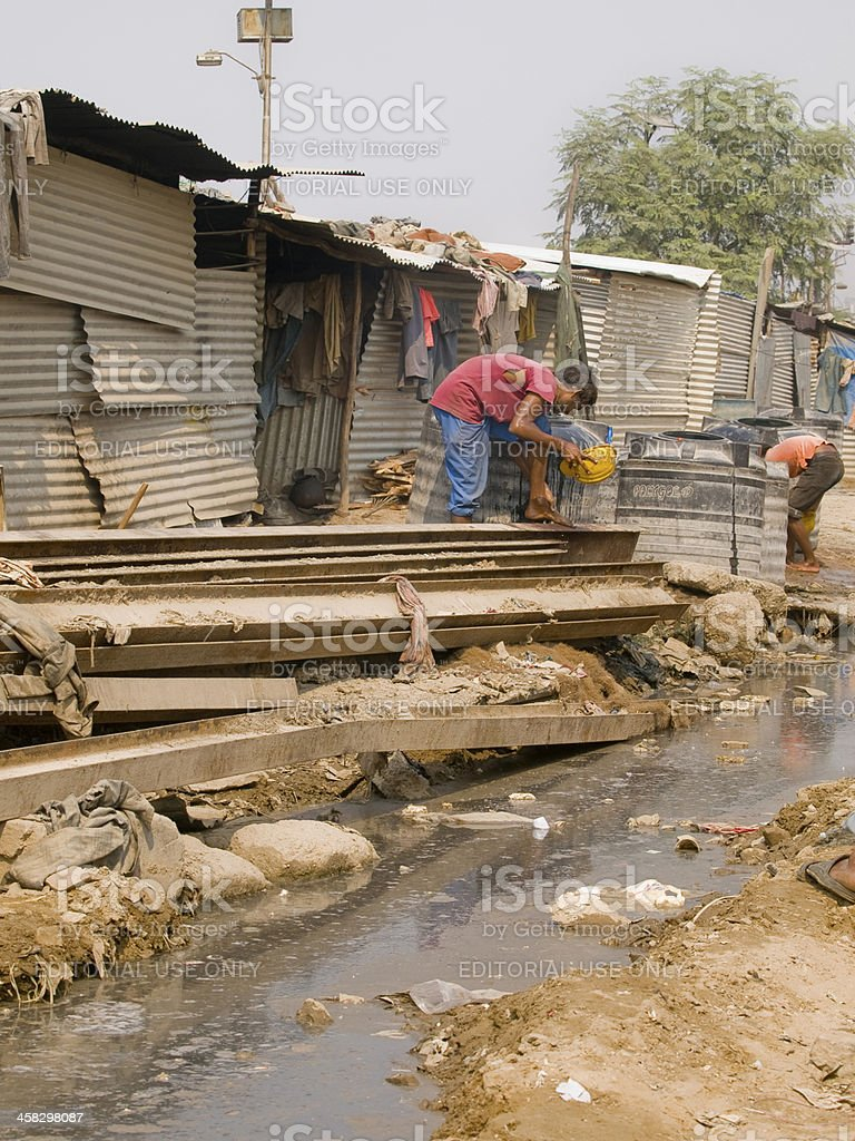Poor man in the slums of India stock photo