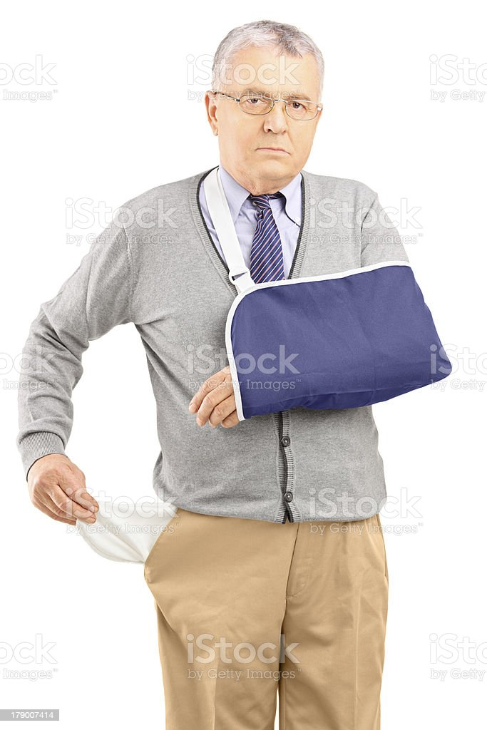 Poor man with broken arm showing his empty pocket royalty-free stock photo