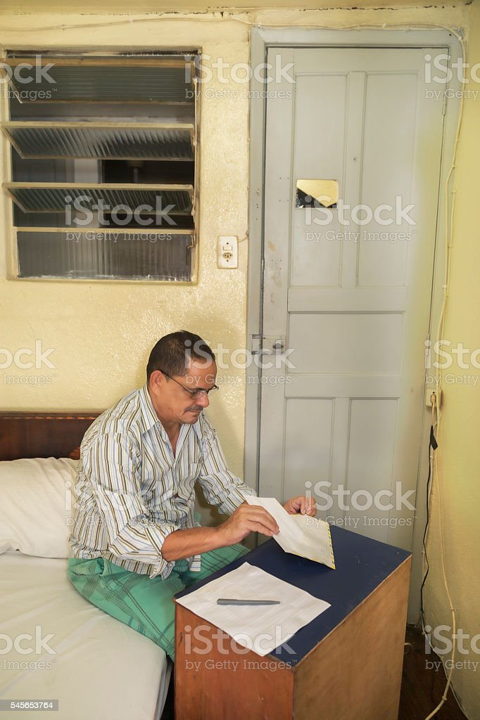 Poor northeastern brazilian man in a very simple hotel stock photo
