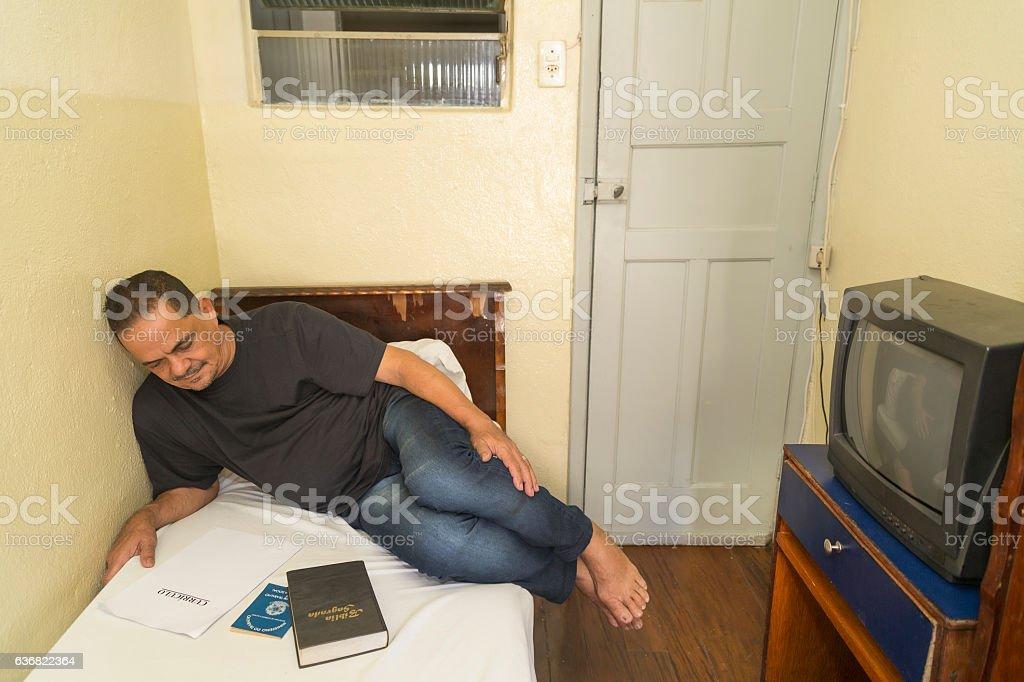 Poor northeastern brazilian man in a very simple hotel stock photo