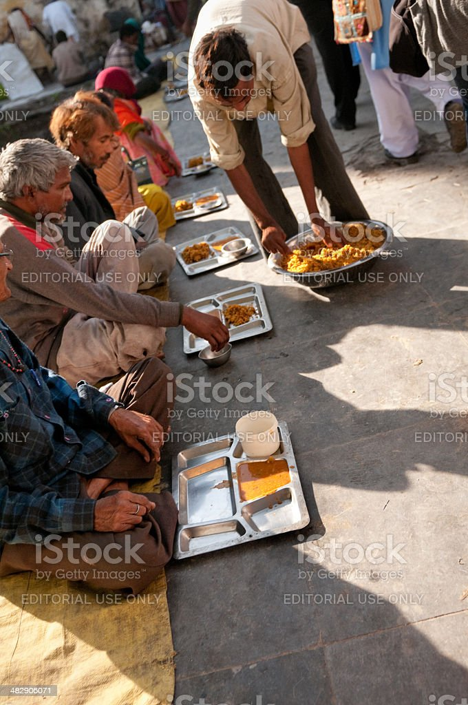 Poor people are fed at Hindu temple in India royalty-free stock photo