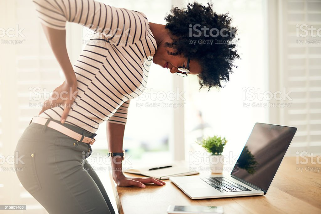 Poor posture can lead to back pain stock photo