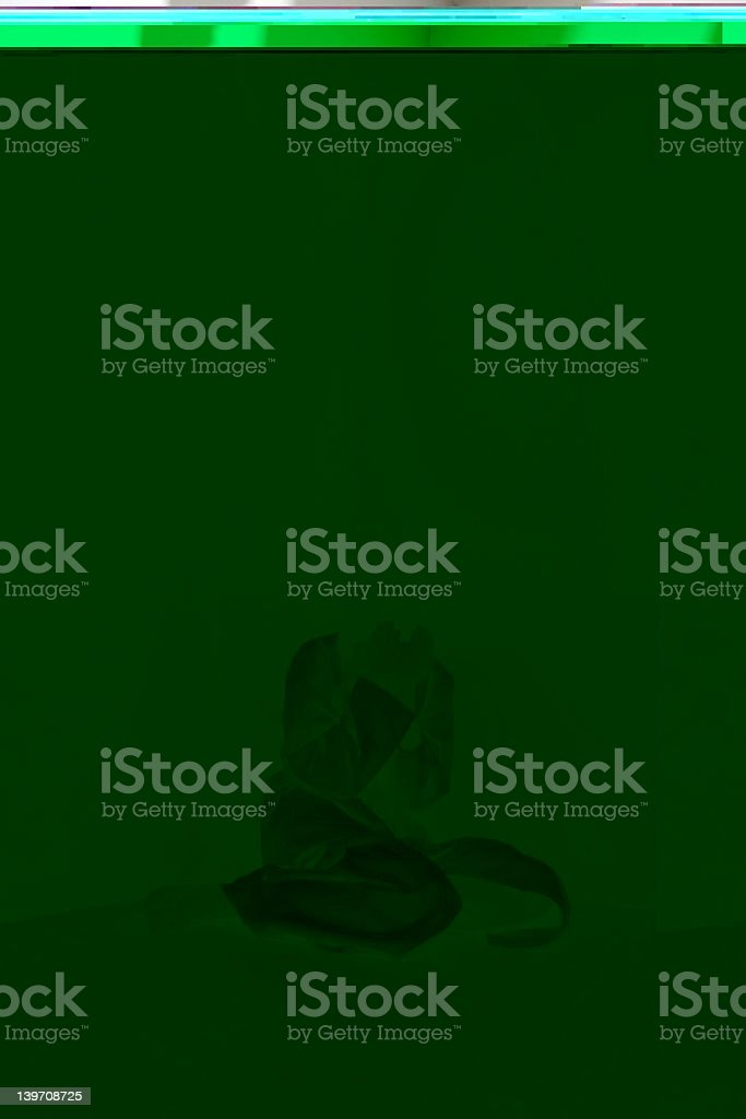 Poor quality green image with feint hunched figure stock photo