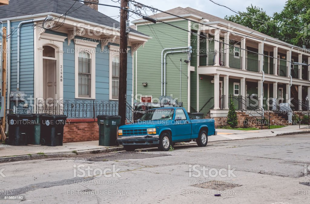 Poor quarter of New Orleans. Worn cars and old houses stock photo