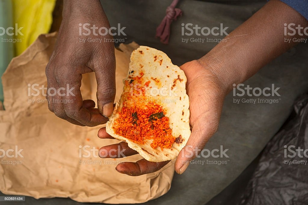 Poor, Sri Lankan, Female Laborer Holding Her Food stock photo