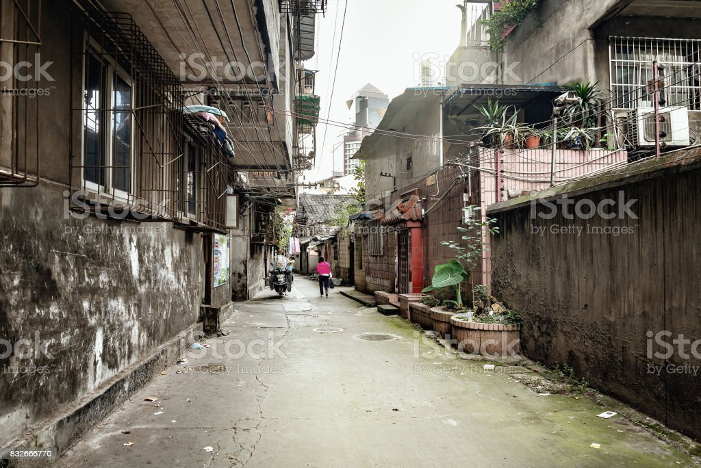 Poor street of Chengdu city by the business district. stock photo