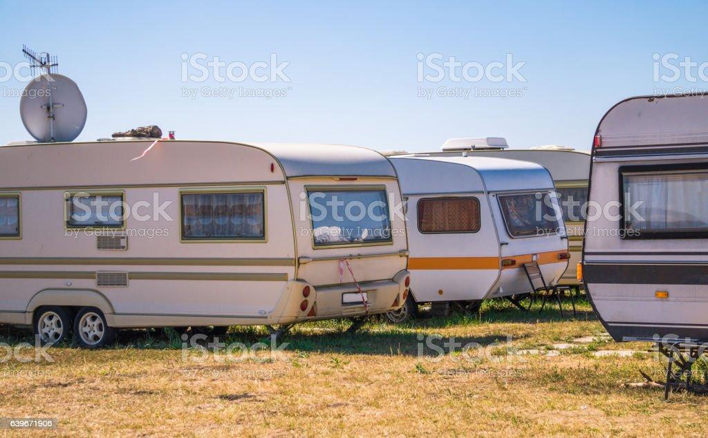 Poor suburbs. Camper vans stock photo