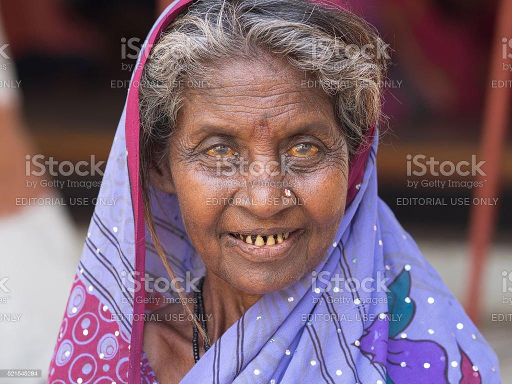 Poor woman in Hampi, India stock photo